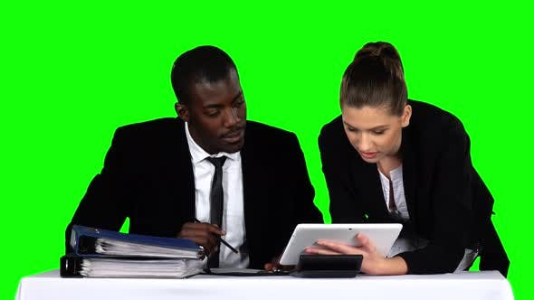 Thumbnail for Business People Working Together While Looking at Charts in Laptop in an Office. Green Screen