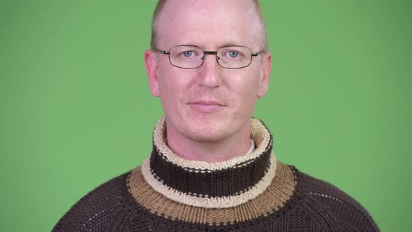 Thumbnail for Happy Mature Bald Man Wearing Turtleneck Sweater and Eyeglasses