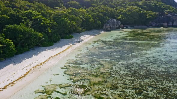 Thumbnail for Aerial Footage of Tropical Paradise Beach Anse Source d'Argent. Shallow Lagoon with Beautiful Algae