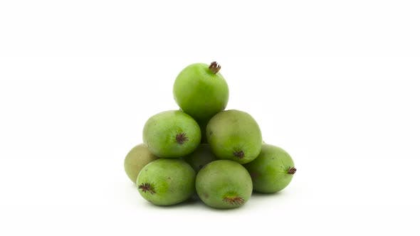 Thumbnail for Heap of Mini Kiwi Fruits. Rotating on the Turntable. Isolated on the White Background. Close-up