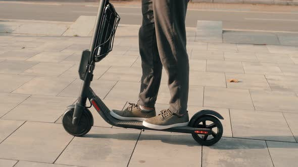 E-scooter Rider, Man Ride Sharing or Rent Personal Eco Transportation. Man Hipster Riding an