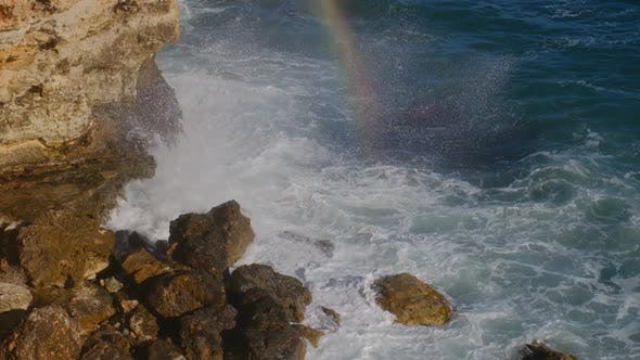 Thumbnail for Sea waves breaking against cliff viewed from above.