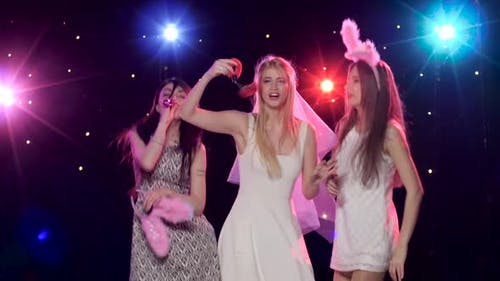 Girls Having Fun at Bachelorette Party Bride with Sexy Gifts