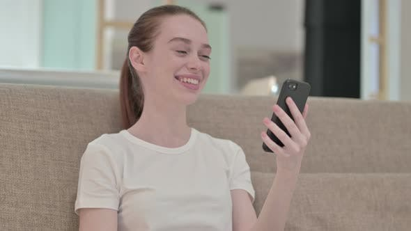 Thumbnail for Surprised Redhead Young Woman Talking on Smart Phone
