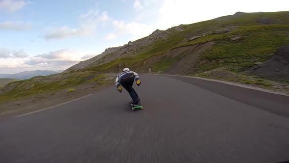 Thumbnail for Longboarder with Impressive Speed Descending To the Foot of the Mountain