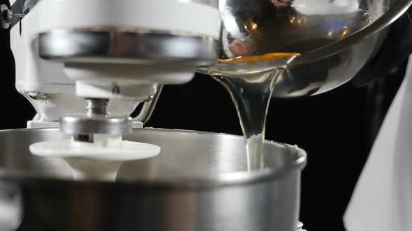Thumbnail for Chef Adding Egg Into Electric Mixer Bowl. Ingredients Are Mixwd To Prepare Dough for Pasta and