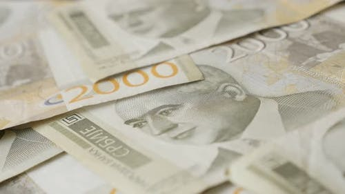 Shallow DOF paper banknotes of Serbia on table close-up 4K 2160p 30fps UltraHD  panning footage - Tw