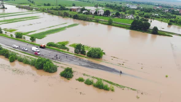 Thumbnail for Flooded Highway. Flooded Road During Floods. Cars That Can Not Pass on the Road Flooded River.