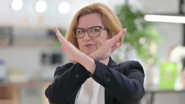 Cover Image for Portrait of Old Businesswoman Saying No By Arm Gesture