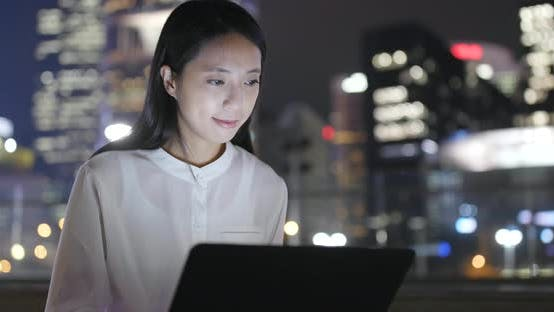 Thumbnail for Business woman use of notebook computer at outdoor