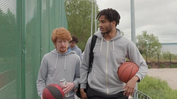 Male Friends Ready to Play Streetball