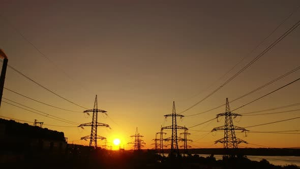 Sunset among high voltage towers