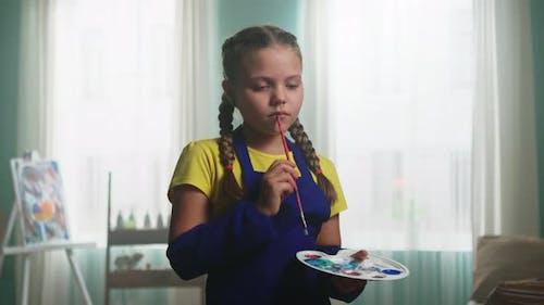 Portrait of Little Girl Artist Reflecting On Art
