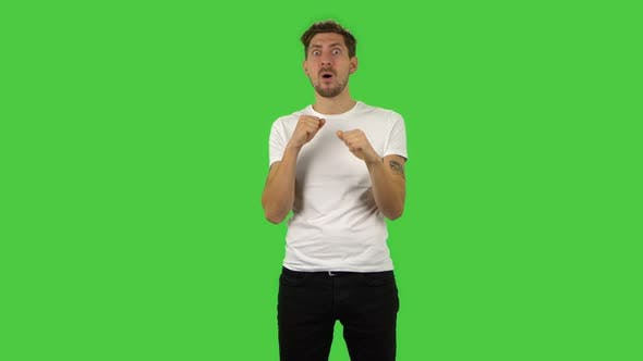 Thumbnail for Confident Guy with Shocked Surprised Wow Face Expression Is Rejoicing. Green Screen