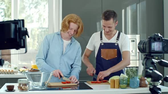Thumbnail for Cooking Show Presenters Slicing Tomatoes