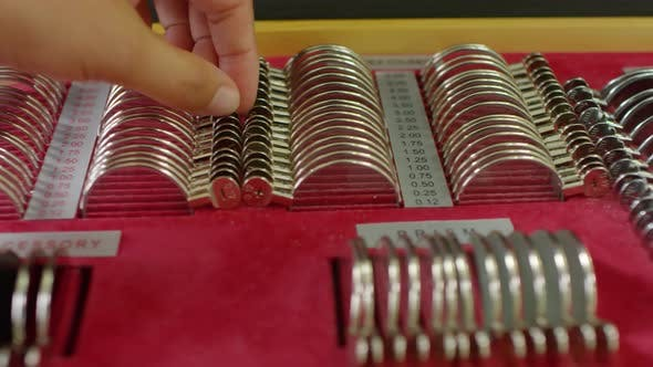Thumbnail for Optometrist Picking Up Lenses for Trial Frame