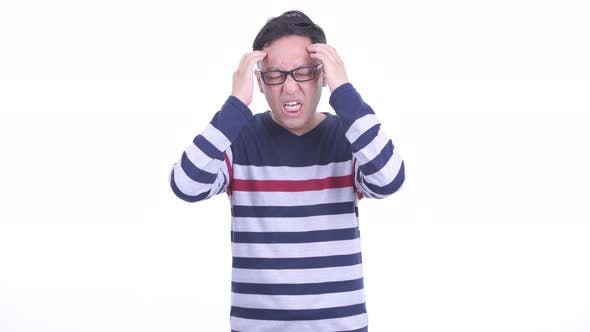 Thumbnail for Stressed Japanese Hipster Man with Eyeglasses Having Headache