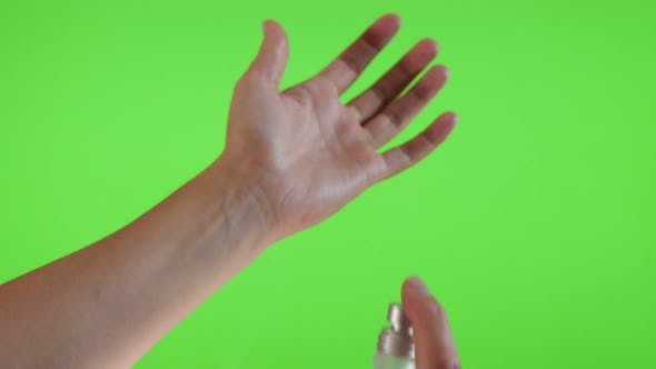 Thumbnail for Parfum bottle  spray applying on the hand in front of green screen 4K 3840X2160 UltraHD footage - Pa