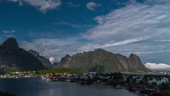Thumbnail for Timelaspe Moving Clouds Over Traditional Small Village in Norway