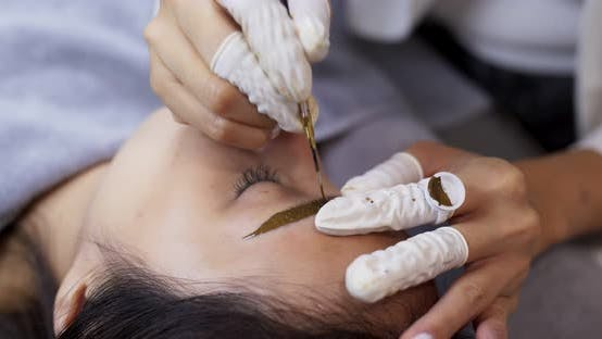 Thumbnail for Young woman gets facial beauty procedure, microblading procedure
