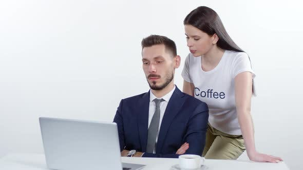 Thumbnail for Woman Tempting Businessman to Drink Coffee