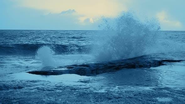 Thumbnail for Surf Wave Crashing on Coastal Rocks