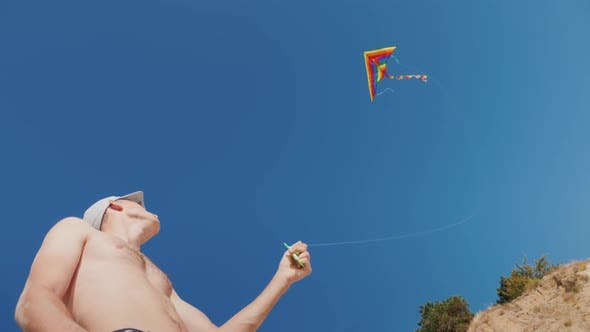 Thumbnail for A Man Is Trying To Fly a Kite