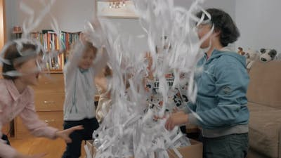 Children excited with paper party