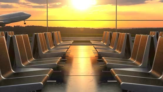 Cover Image for Passenger Airplane Landing Against Sunset As Seen Through Departure Hall Windows