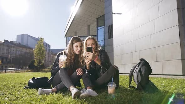 Cover Image for Attractive Teen Girlfriends with Smartphone Laughing