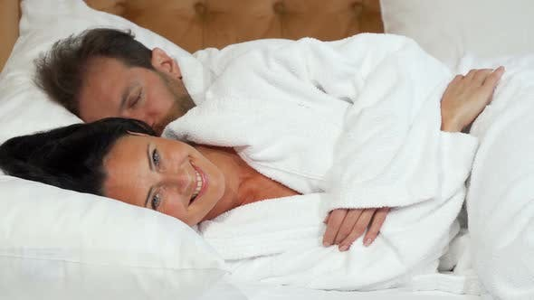 Thumbnail for Cheerful Mature Woman Going To Sleep Lying in the Bed with Her Husband