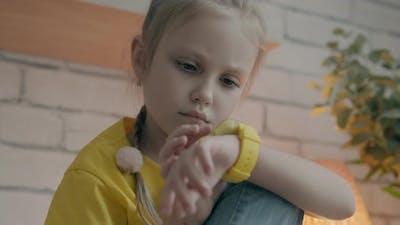 Little Girl Using Her Kids Smart Watch