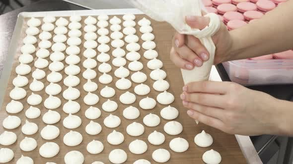 Thumbnail for Shot of a Pastry Chef Preparing Meringues at the Kitchen