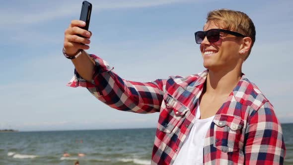 Thumbnail for Man with Smartphone Taking Selfie on Summer Beach