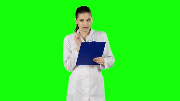Thumbnail for Nurse or Young Doctor Writing on Medical File Clipboard. Green Screen