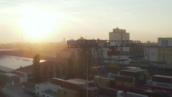 Thumbnail for Port in Early Morning Sunrise with Cargo Containers and Cranes, Aerial Foward