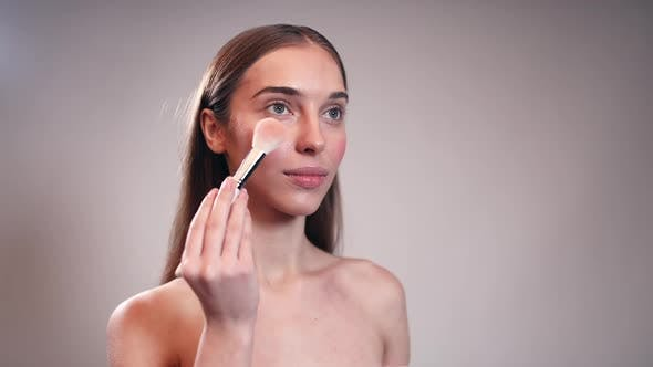 Cover Image for Beautiful Girl Using Make Up Brush