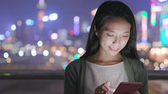 Thumbnail for Young Woman Use of Mobile Phone at Night