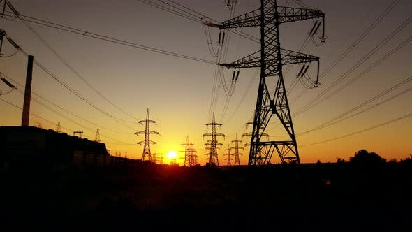 Transmission electric on towers at sunset