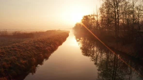 Quiet Foggy Stream During Sunrise Jutland