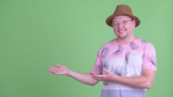 Thumbnail for Happy Overweight Bearded Tourist Man Showing Something
