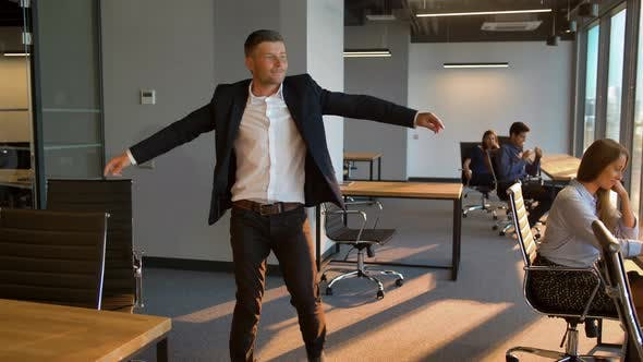 Thumbnail for Businesspeople Looking at Dancing Male Colleague