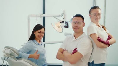 Dentist Assistant and Patient in the Dentist's Office