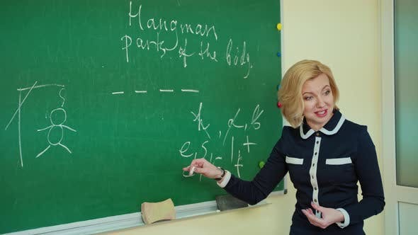 Pedagogue teaches near the board