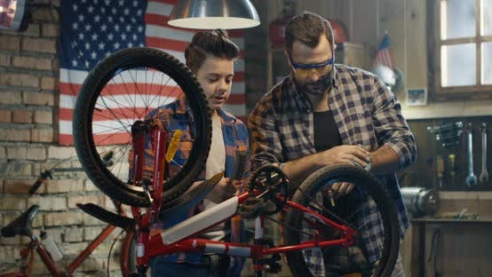 Thumbnail for Father and Son Repairing a Bike in a Garage