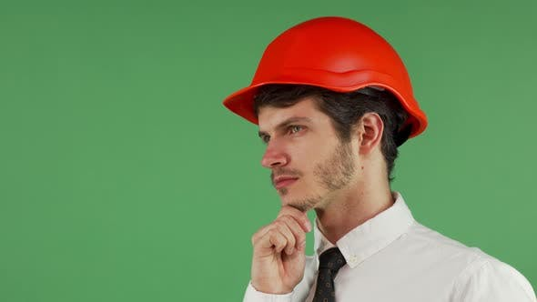 Thumbnail for Handsome Male Constructionist in a Hardhat Looking Away Thoughtfully