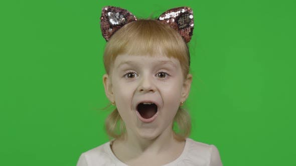 Girl in Headband with a Cat Ears Shows Amazement