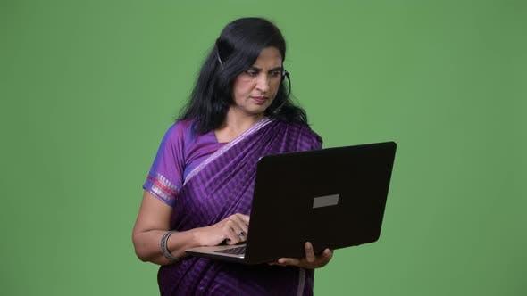 Thumbnail for Mature Beautiful Indian Woman As Call Center Representative Using Laptop