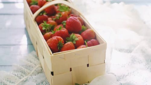 Summer Picnic with Strawberries on the Grass and Full Basket