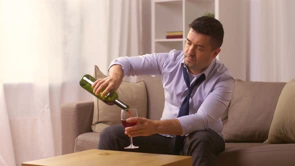 Thumbnail for Alcoholic Pouring Red Wine To Glass at Home
